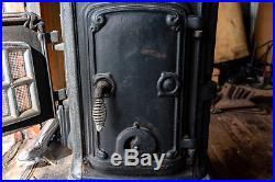 Vintage wood burning cast iron parlor stove (with original manual)