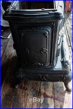 Vintage Wood Burning Cast Iron Parlor Stove With Original Manual Wood Burning Stove