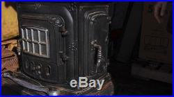 Washington Stove Works Vintage wood burning cast iron Parlor stove